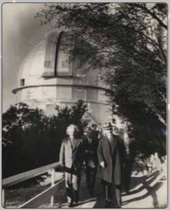 Picture of Einstein, Walter Mayer, and William Campbell outside the Mt. Wilson Observatory